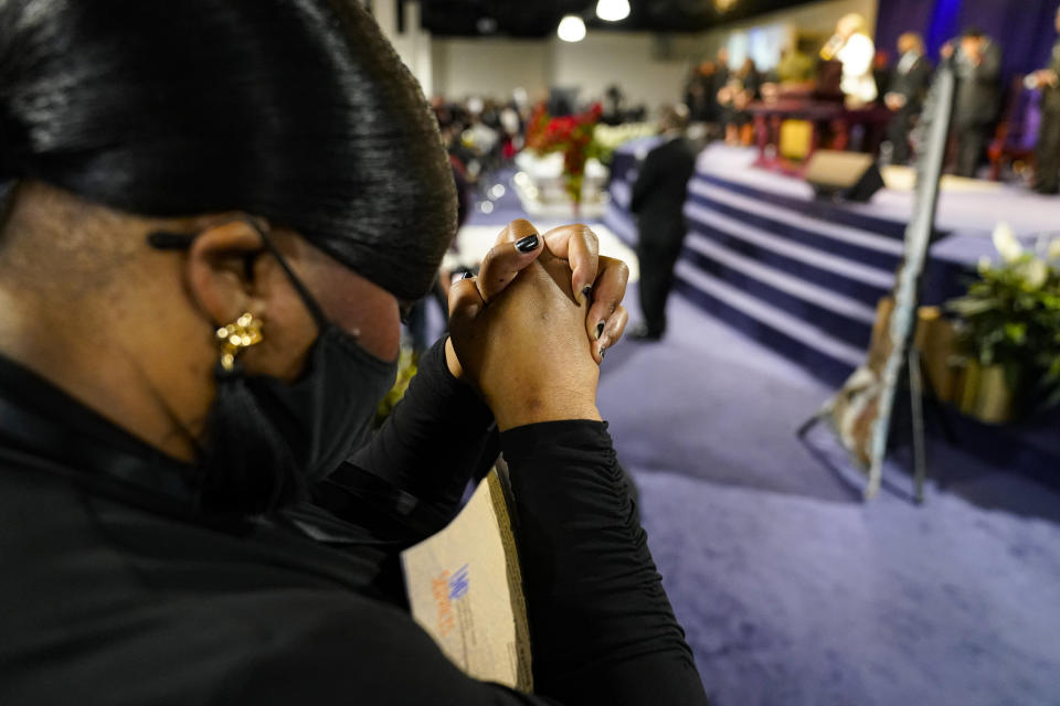 A mourner prays during funeral services for Daunte Wright at Shiloh Temple International Ministries in Minneapolis, Thursday, April 22, 2021. Wright, 20, was fatally shot by a Brooklyn Center, Minn., police officer during a traffic stop. (AP Photo/John Minchillo, Pool)