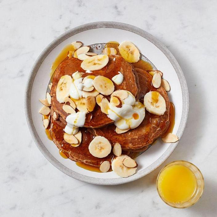 "<p>These plant-powered pancakes, which skip the syrup and instead get a natural sugar boost from bananas, honey, and nuts, have a seal of approval from Jones. A stack of these things is especially nice if find yourself craving sweet snacks with your caffeine.</p><p><strong><em><a href=""https://www.prevention.com/food-nutrition/recipes/a34465332/peanut-butter-banana-pancakes-recipe/"" rel=""nofollow noopener"" target=""_blank"" data-ylk=""slk:Get the recipe »"" class=""link rapid-noclick-resp"">Get the recipe »</a></em></strong></p>"