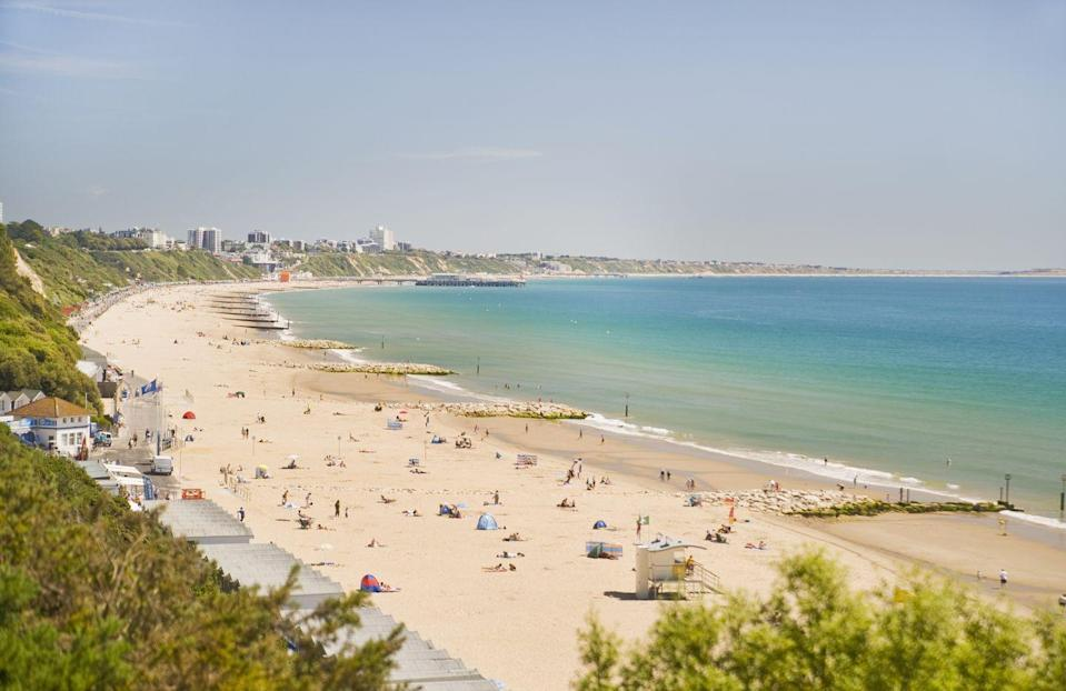 "<p>Wander from Bournemouth town centre towards the coast and it'll be hard to miss the sweeping golden sands, backed by the cutest beach houses. </p><p><a class=""link rapid-noclick-resp"" href=""https://www.airbnb.co.uk/"" rel=""nofollow noopener"" target=""_blank"" data-ylk=""slk:FIND AN AIRBNB"">FIND AN AIRBNB</a></p>"