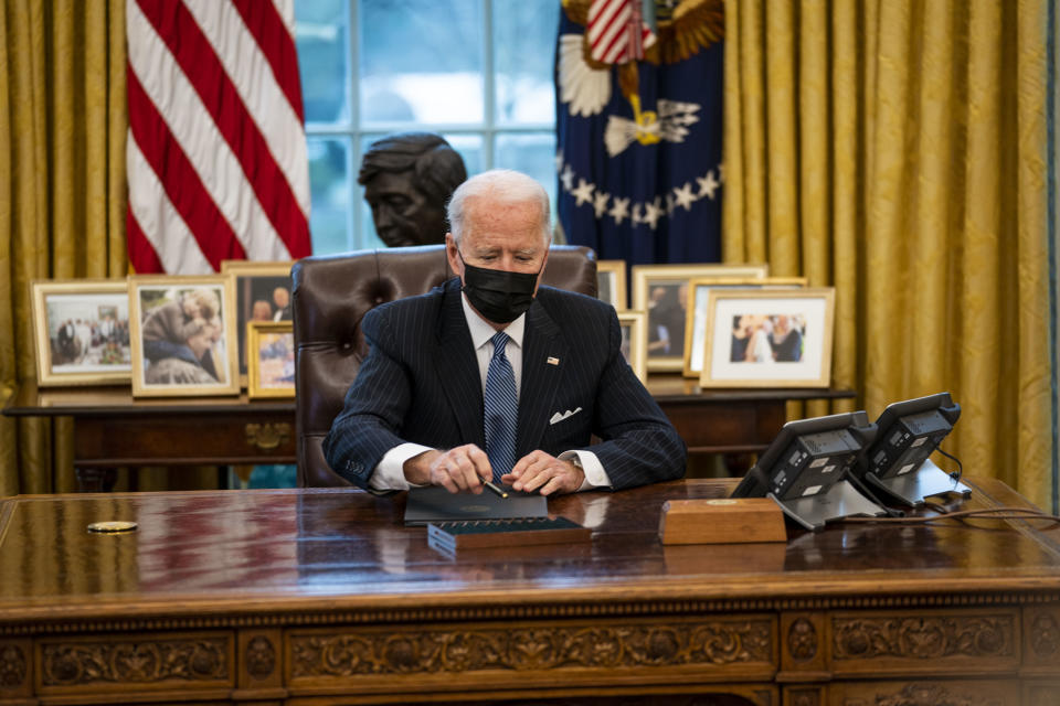 President Joe Biden prepares to sign an executive order in the Oval Office of the White House on Jan. 25, repealing the ban on transgender people serving openly in the military. (Photo: Doug Mills-Pool/Getty Images)