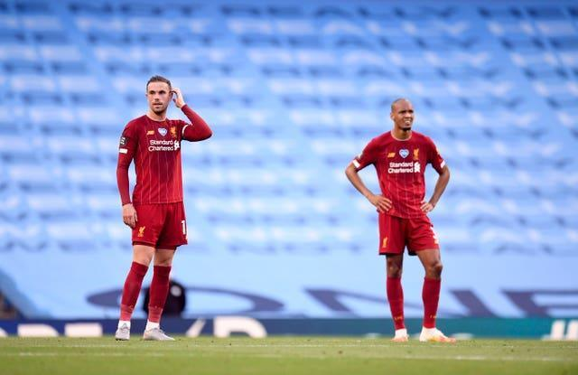 Liverpool midfielders Jordan Henderson and Fabinho together on the pitch