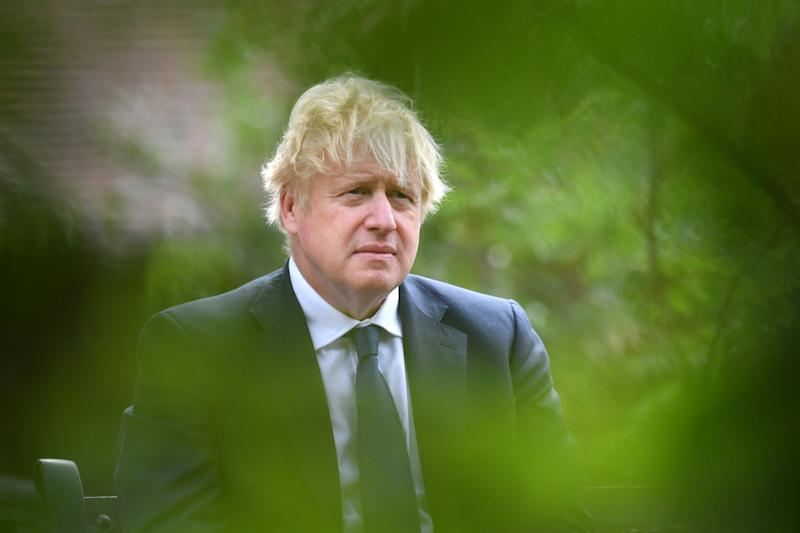 Britain's Prime Minister Boris Johnson attends a national service of remembrance at the National Memorial Arboretum in Alrewas, central England on August 15, 2020, to mark the 75th anniversary of VJ (Victory over Japan) Day. (Photo by Anthony Devlin / POOL / AFP) (Photo by ANTHONY DEVLIN/POOL/AFP via Getty Images)