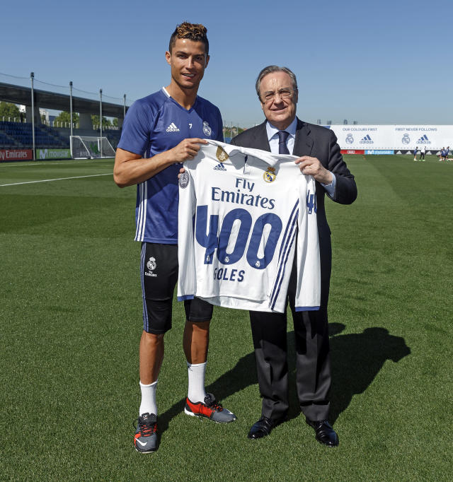 <p>400 goals up for CR7. Here he is being presented with a shirt by Florentino Perez. </p>