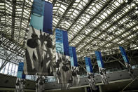 Tokyo 2020 banners adorn the main press center of the 2020 Summer Olympics, Monday, July 12, 2021, in Tokyo. (AP Photo/Jae C. Hong)