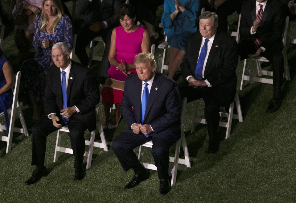 WASHINGTON,  - AUGUST 25:  (Clockwise from lower right) U.S. President Donald Trump, Vice President Mike Pence, Amalija Knavs and Viktor Knavs, parents of the first lady Melania Trump, listen to the first lady's address to the Republican National Convention from the Rose Garden at the White House on August 25, 2020 in Washington, DC. The convention is being held virtually due to the coronavirus pandemic but will include speeches from various locations including Charlotte, North Carolina and Washington, DC.  (Photo by Alex Wong/Getty Images)