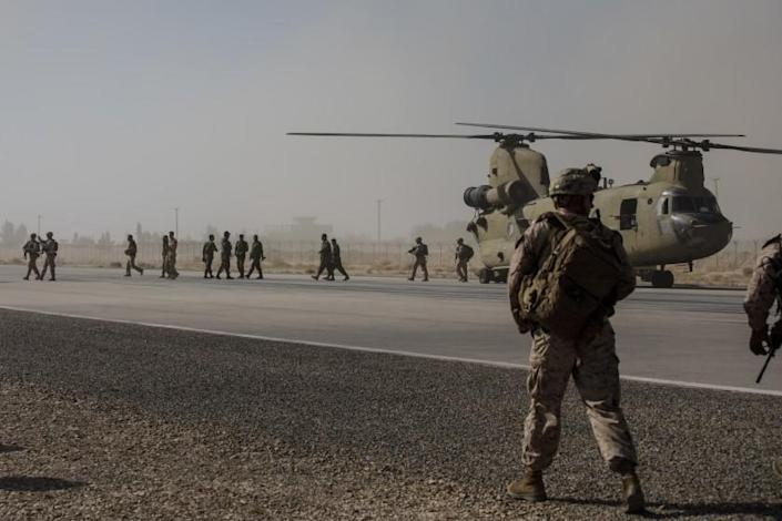 CAMP BOST, HELMAND PROVINCE -- SUNDAY, OCTOBER 29, 2017: U.S. Marines disembark from a U.S. Army helicopter at Camp Bost, Helmand Province, on Oct. 29, 2017. About 300 U.S. Marines are deployed in Helmand Province, in southern Afghanistan to train, advice and assist Afghan security forces who are battling the Taliban. The move puts Americans back in a combat role in Helmand province, where Marines fought for more than a decade before they were withdrawn in 2014. (Marcus Yam / Los Angeles Times)