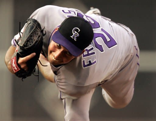 Colorado Rockies pitcher Jeff Francis watches his throw in the first inning of a baseball game with the Philadelphia Phillies, Thursday, June 21, 2012, in Philadelphia. (AP Photo/Tom Mihalek)