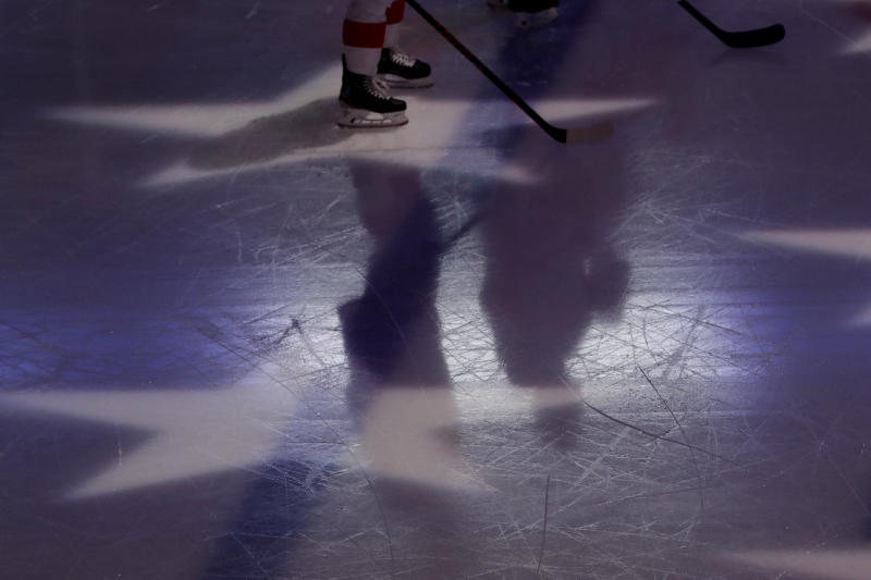 Detroit Red Wings' Dylan Larkin, left, and Brian Lashoff stand on the ice for the singing of the national anthem before an NHL hockey game against the Chicago Blackhawks in Chicago, Sunday, Jan. 5, 2020. (AP Photo/Nam Y. Huh)