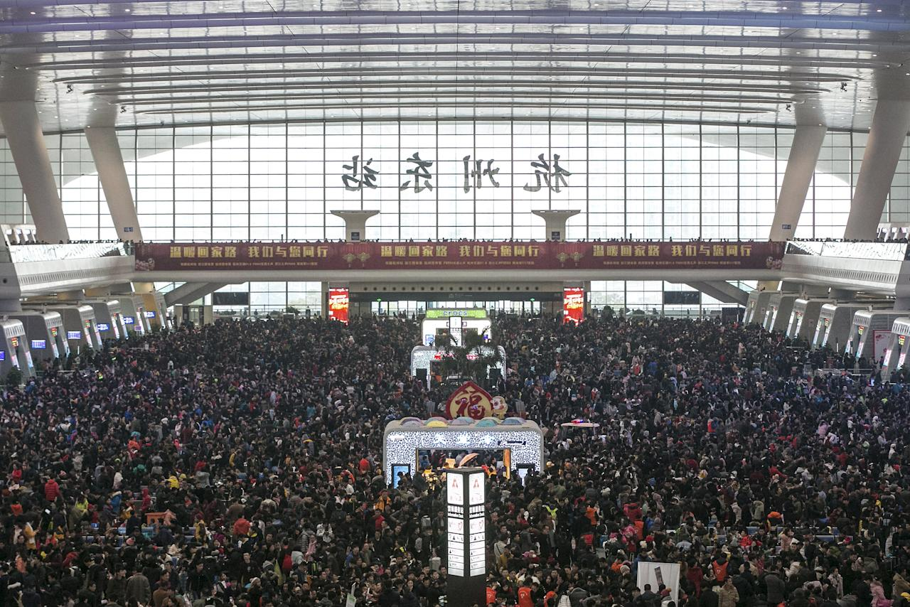 Passengers crowd at the waiting hall inside a railway station after trains were delayed due to heavy snow, during the travel rush ahead of the upcoming Spring Festival, in Hangzhou, Zhejiang province