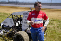 Jeff Gordon, a five-time winner of the Brickyard 400 and four-time NASCAR Cup Series champion, talks about driving a USAC midget car after taking some exhibition laps on the dirt track in the infield at Indianapolis Motor Speedway in Indianapolis, Thursday, June 17, 2021. (AP Photo/Michael Conroy)