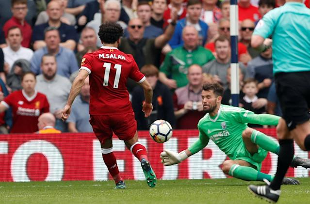 """Soccer Football - Premier League - West Bromwich Albion v Liverpool - The Hawthorns, West Bromwich, Britain - April 21, 2018 Liverpool's Mohamed Salah scores their second goal Action Images via Reuters/Andrew Boyers EDITORIAL USE ONLY. No use with unauthorized audio, video, data, fixture lists, club/league logos or """"live"""" services. Online in-match use limited to 75 images, no video emulation. No use in betting, games or single club/league/player publications. Please contact your account representative for further details."""