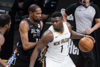 Brooklyn Nets' Kevin Durant (7) defends New Orleans Pelicans' Zion Williamson (1) during the first half of an NBA basketball game Wednesday, April 7, 2021, in New York. (AP Photo/Frank Franklin II)