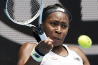 "Cori ""Coco"" Gauff of the U.S. makes a forehand return to Romania's Sorana Cirstea during their second round singles match at the Australian Open tennis championship in Melbourne, Australia, Wednesday, Jan. 22, 2020. (AP Photo/Lee Jin-man)"