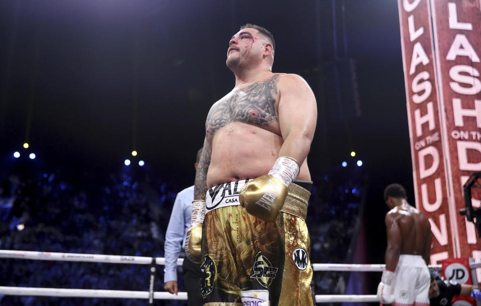 Defending champion Andy Ruiz Jr., left, walks back to his corner at the end of a round after getting cut during his fight against Britain's Anthony Joshua in their World Heavyweight Championship contest at the Diriyah Arena, Riyadh, Saudi Arabia. (Nick Potts/PA via AP)