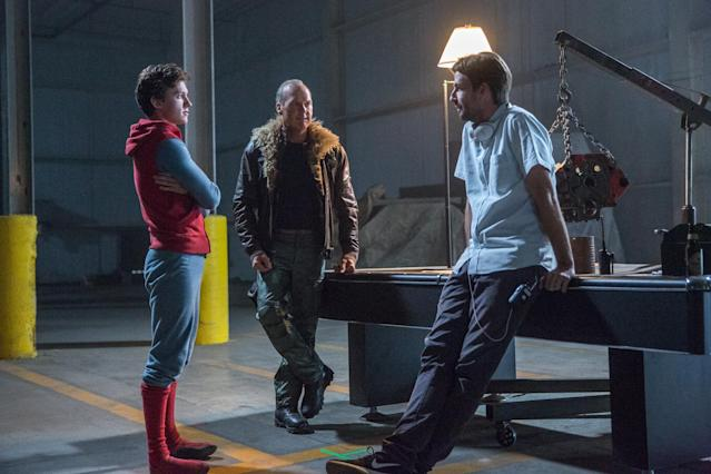"""Tom Holland (in """"homemade"""" Spidey suit), Michael Keaton, and director Jon Watts on the set of <i>Spider-Man: Homecoming</i>. (Photo: Columbia Pictures)"""