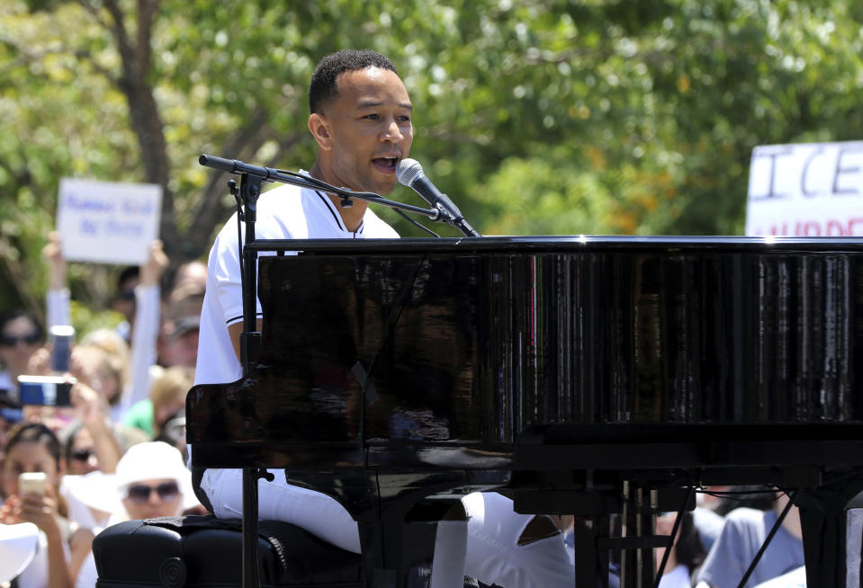 """FILE - In this June 30, 2018, file photo, John Legend performs at the """"Families Belong Together: Freedom for Immigrants"""" March in Los Angeles. Legend, Janet Jackson, The Weeknd and Shawn Mendes are among the artists slated to appear at the 2018 Global Citizen Festival. The event will take place on Sept. 29 on the Great Lawn in New York City's Central Park. (Photo by Willy Sanjuan/Invision/AP, File)"""