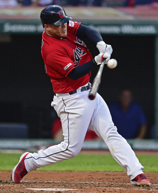 Cleveland Indians' Roberto Perez hits a two-RBI single in the fourth inning of a baseball game against the Minnesota Twins, Friday, July 12, 2019, in Cleveland. (AP Photo/David Dermer)