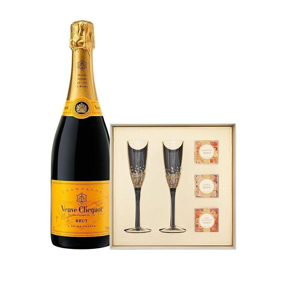 """<p><strong>Veuve Clicquot</strong></p><p>reservebar.com</p><p><strong>$105.00</strong></p><p><a href=""""https://go.redirectingat.com?id=74968X1596630&url=https%3A%2F%2Fwww.reservebar.com%2Fproducts%2Fveuve-clicquot-yellow-label-750ml-with-sugarfina-pop-the-champagne-gift-set&sref=https%3A%2F%2Fwww.bestproducts.com%2Feats%2Ffood%2Fg2079%2Ftasty-food-gifts-for-foodies%2F"""" rel=""""nofollow noopener"""" target=""""_blank"""" data-ylk=""""slk:Shop Now"""" class=""""link rapid-noclick-resp"""">Shop Now</a></p><p>What foodie doesn't love a classic Yellow Label bottle of Veuve? Paired with delicious, bubbly-inspired gummy treats from Sugarfina and two gorgeous flutes, this sweet and classic foodie gift is perfect for literally any celebratory occasion.</p>"""