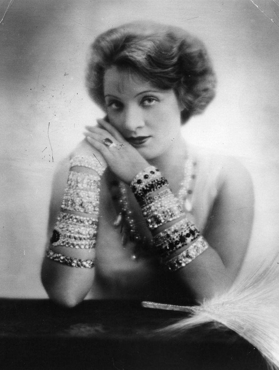 <p>Dietrich sits for a portrait and proves maximalism - thanks to her stacks of jeweled bangles and bracelets - is still alive and strong. <br></p>