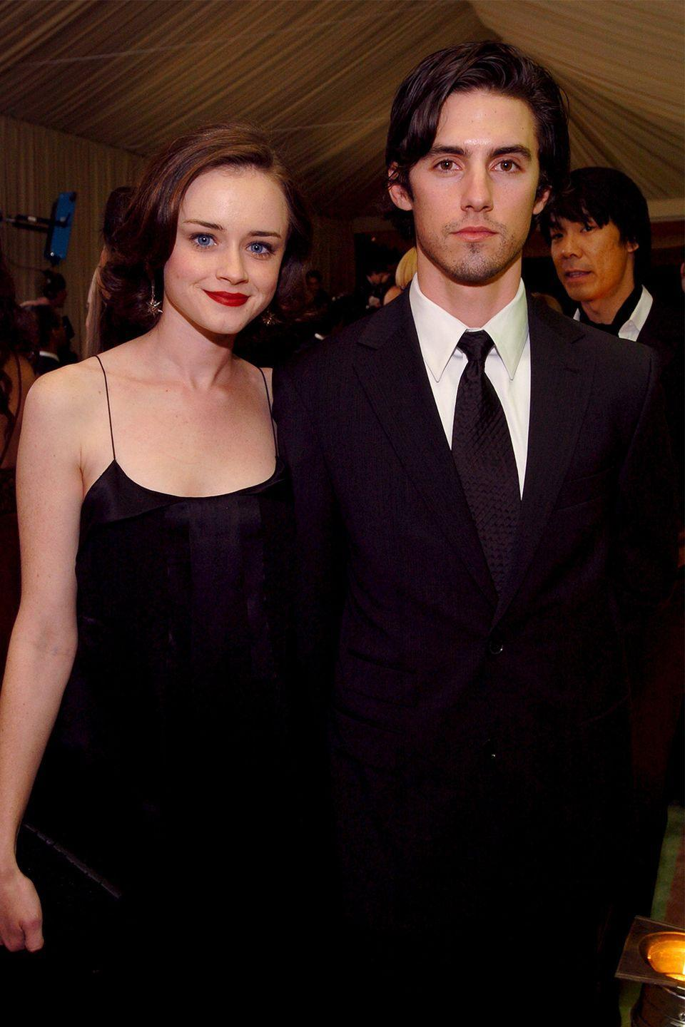 """<p>The on-screen couple (a.k.a Rory Gilmore and Jess Mariano) also dated in real life. Their romance began in 2001, just one year after becoming <em>Gilmore Girls</em> co-stars. And though Bledel said they had talked about marriage, the two split up after four years together.</p><p>""""I think everybody who has been dating for more than a couple of years probably talks about it at some point,"""" Bledel <a href=""""https://www.popsugar.com/celebrity/Did-Milo-Ventimiglia-Alexis-Bledel-Date-Real-Life-44016121"""" rel=""""nofollow noopener"""" target=""""_blank"""" data-ylk=""""slk:told"""" class=""""link rapid-noclick-resp"""">told </a><em><a href=""""https://www.popsugar.com/celebrity/Did-Milo-Ventimiglia-Alexis-Bledel-Date-Real-Life-44016121"""" rel=""""nofollow noopener"""" target=""""_blank"""" data-ylk=""""slk:People"""" class=""""link rapid-noclick-resp"""">People</a> </em>back in September 2005. """"It's a fun thing for us to talk about, but that's it.""""<br></p>"""