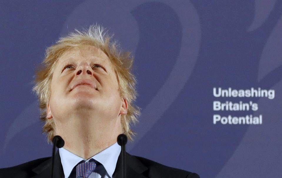 """Britain's Prime Minister Boris Johnson reacts as he delivers a speech at the Old Royal Naval College in Greenwich, south east London on February 3, 2020. - Britain on Monday said it wanted a """"thriving trade and economic relationship"""" with the European Union, as it set out its position for future trade talks after it left the bloc. But Prime Minister Boris Johnson pledged: """"We will not engage in some cut-throat race to the bottom. We are not leaving the EU to undermine European standards. We will not engage in any kind of dumping, whether commercial, social or environmental."""" (Photo by Frank Augstein / various sources / AFP) (Photo by FRANK AUGSTEIN/AP/AFP via Getty Images)"""