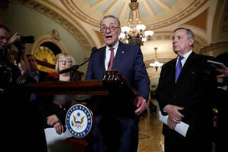 Senate Minority Leader Chuck Schumer, accompanied by Sen. Dick Durbin (D-IL) and Sen. Patty Murray (D-WA), speaks with reporters following the party luncheons on Capitol Hill in Washington, U.S. January 23, 2018. REUTERS/Aaron P. Bernstein