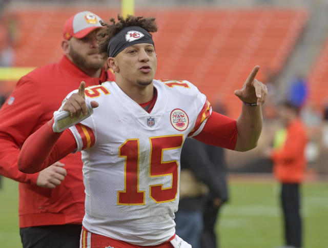 Kansas City Chiefs quarterback Patrick Mahomes smiles as he runs off the field after the team defeated the Cleveland Browns in an NFL football game, Sunday, Nov. 4, 2018, in Cleveland. (AP Photo/David Richard)