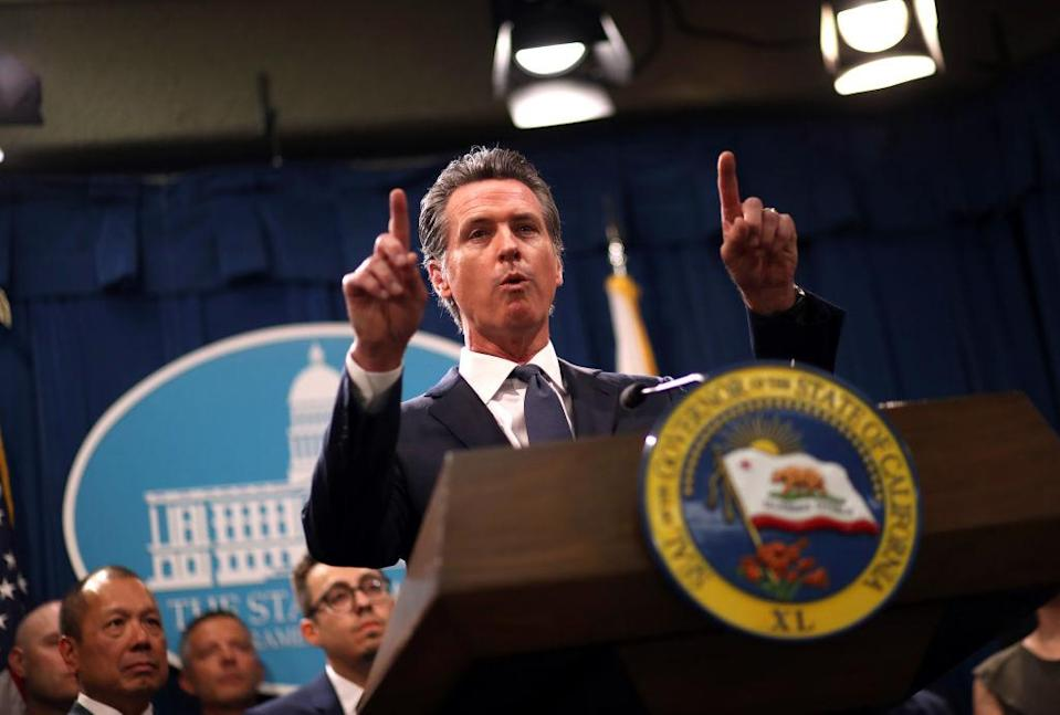 "SACRAMENTO, CALIFORNIA - AUGUST 16: California Gov. Gavin Newsom speaks during a news conference with California attorney General Xavier Becerra at the California State Capitol on August 16, 2019 in Sacramento, California. California attorney genera Xavier Becerra and California Gov. Gavin Newsom announced that the State of California is suing the Trump administration challenging the legality of a new ""public charge"" rule that would make it difficult for immigrants to obtain green cards who receive public assistance like food stamps and Medicaid. (Photo by Justin Sullivan/Getty Images)"