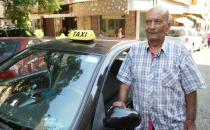 Zakaria Ghalayeeni, 76-year-old Lebanese taxi driver, stands next to his car in Beirut