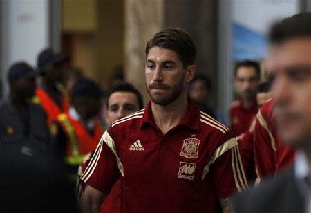 Spain's Sergio Ramos arrives at the O. R. Tambo International Airport, ahead of Tuesday's international friendly soccer match against South Africa at Soccer City, in Johannesburg, November 17, 2013. REUTERS/Siphiwe Sibeko