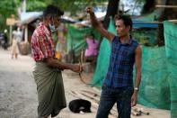 Man selling eels in Yangon slum during coronavirus lockdown