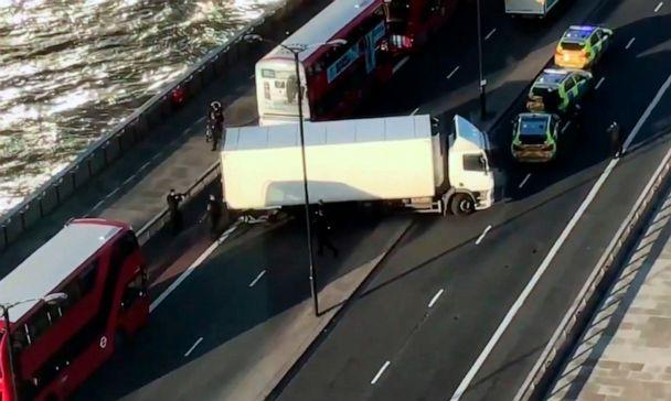 PHOTO: In this image made from video provided by Luke Poulton, armed police surround a truck parked across lanes of traffic on London Bridge, following an incident in central London, Nov. 29, 2019. (Luke Poulton via AP)
