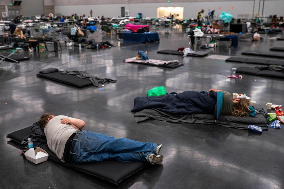 People gather at a 'cooling centre' to escape the heat amid record-breaking temperatures in Portland, Oregon (Getty)