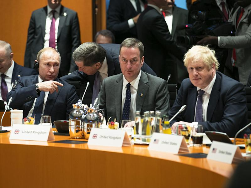 Boris Johnson and Vladimir Putin are pictured before the beginning of the meeting in Berlin, Germany: Getty Images