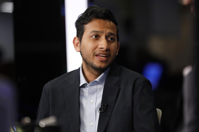 Ritesh Agarwal, founder and CEO of OYO Rooms, is interviewed on the floor of the New York Stock Exchange, Tuesday, Feb. 18, 2020. (AP Photo/Richard Drew)