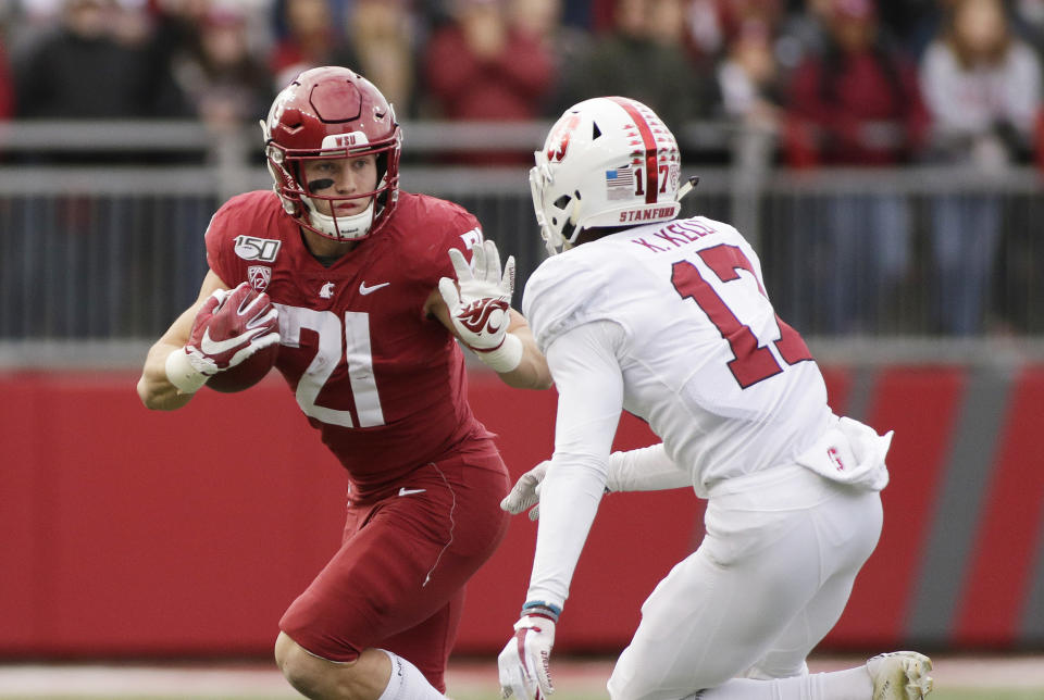 FILE - In this Nov. 16, 2019, file photo, Washington State running back Max Borghi (21) carries the ball while pursued by Stanford cornerback Kyu Blu Kelly (17) during the first half of an NCAA college football game in Pullman, Wash. Washington State could get a game-changing addition to its lineup if Borghi is able to make his season debut. The junior is coming off a season in which he rushed for 817 yards and 11 touchdowns while catching a team-high 86 passes for 597 yards and five more TDs. He missed the Cougars' first two games of this season with an undisclosed injury, but he returned to practice this week. (AP Photo/Young Kwak, File)
