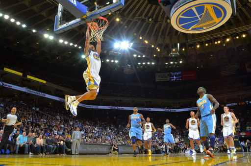 OAKLAND, CA - APRIL 07: Dominic McGuire #5 of the Golden State Warriors dunks the ball against the Denver Nuggets on April 07, 2012 at Oracle Arena in Oakland, California. (Photo by Rocky Widner/NBAE via Getty Images)