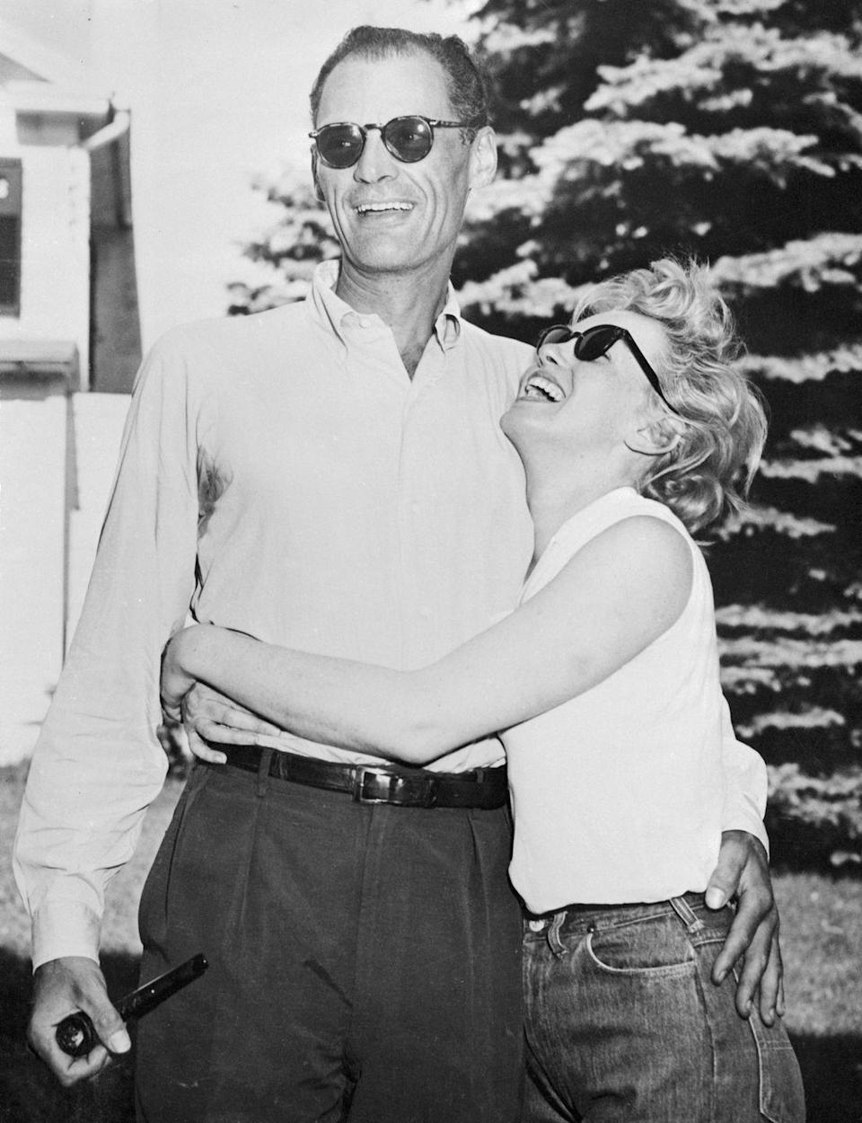 <p>With then-fiancé Arthur Miller at the playwright's summer home on June 25. They got married four days later. </p>