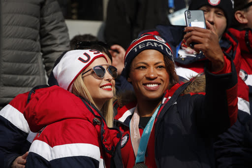 Silver medalist of the women's two-man bobsled, Lauren Gibbs of the United States, right, takes a selfie with Ivanka Trump during the third heat of the four-man bobsled competition final at the 2018 Winter Olympics in Pyeongchang, South Korea, Sunday, Feb. 25, 2018. (AP Photo/Christophe Ena)