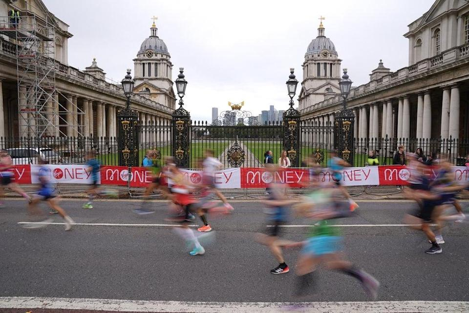 Runners pass the Old Naval College, Greenwich (Jonathan Brady/PA) (PA Wire)