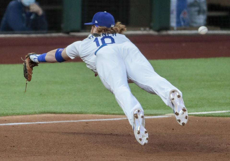 Dodgers third baseman Justin Turner can't corral a run-scoring double by Atlanta's Cristian Pache.