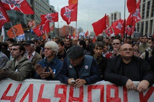 Opposition activists and supporters take part in an anti-Putin protest in central in Moscow. A sea of protestors, brandishing the red flags of socialism, nationalist tricolours or liberal slogans, filled the avenue in Moscow named after the great Soviet physicist and celebrated dissident Andrei Sakharov