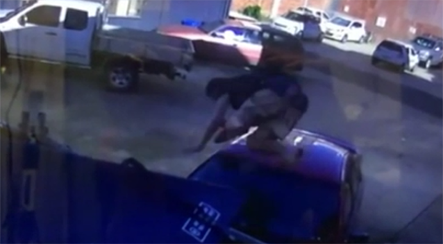The man body-slams the car multiple times from above. Source: Daily Mercury