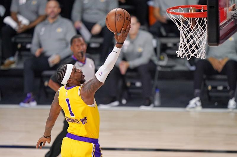 Lakers center Kentavious Caldwell-Pope scores against the Denver Nuggets during the first half of the Lakers' win.