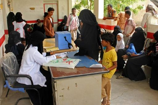Displaced Yemenis who fled battles in Hodeida wait for a medical check in the northern district of Abs