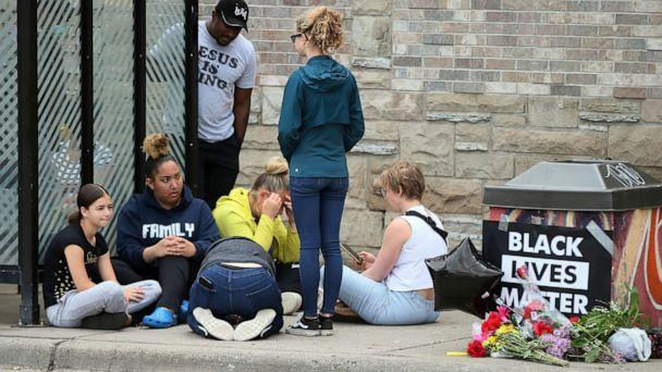 PHOTO: Mourners gather around a makeshift memorial, Tuesday, May 26, 2020 in Minneapolis, near where an black man was taken into police custody the day before who later died. (Jim Mone/AP)