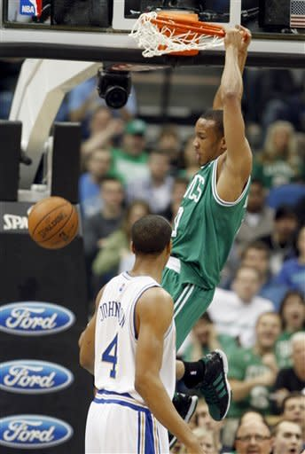 Boston Celtics guard Avery Bradley (0) dunks the ball as Minnesota Timberwolves guard Wesley Johnson (4) watches during the first quarter of an NBA basketball game on Friday, March 30, 2012, in Minneapolis. (AP Photo/Genevieve Ross)