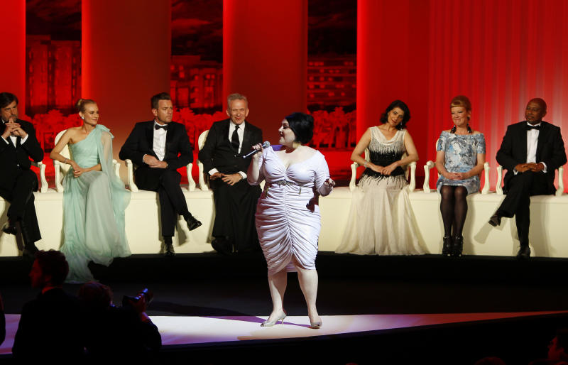 Singer Beth Ditto, at front, performs as members of the jury from left, Nanni Moretti, Diane Kruger, Ewan McGregor, Jean-Paul Gaultier, Hiam Abbass, Andrea Arnold, and Raoul Peck at the opening ceremony at the 65th international film festival, in Cannes, southern France, Wednesday, May 16, 2012. (AP Photo/Francois Mori)