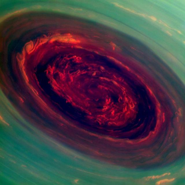 The spinning vortex of Saturn's north polar storm resembles a deep red rose of giant proportions surrounded by green foliage in this false-color image from NASA's Cassini spacecraft. Measurements have sized the eye at a staggering 1,250 miles (2,000 kilometers) across with cloud speeds as fast as 330 miles per hour (150 meters per second). (Courtesy: NASA/JPL-Caltech/SSI)
