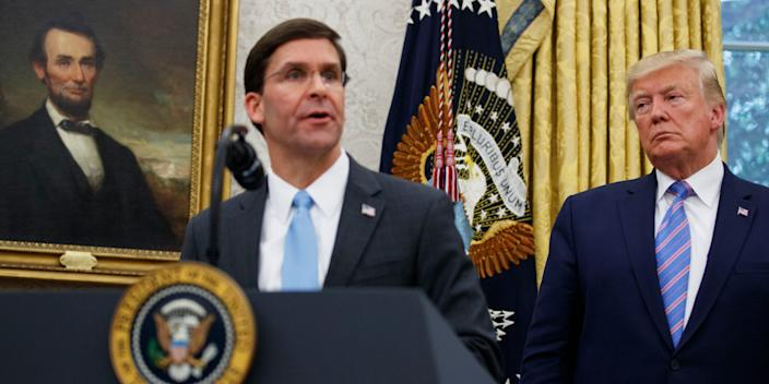 <br>Secretary of Defense Mark Esper with President Donald Trump during a ceremony in the Oval Office on July 23.